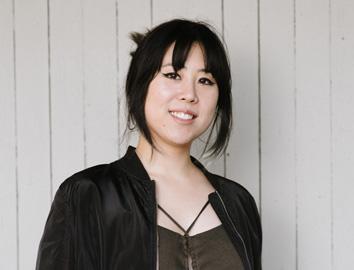 Headshot of Alexis van den Berg, founder of AV Creative Designs