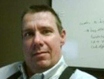 Headshot of Gary Angel