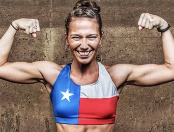 Photo of Cristin Curl in a red, white, and blue sports bra, flexing
